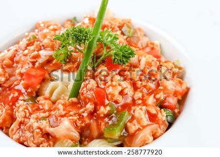 Stir-fried macaroni and pork on white background - stock photo