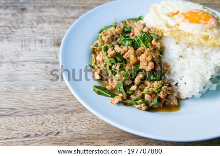Stir-fried minced pork with holy basil and steamed rice (Thai food) - stock photo
