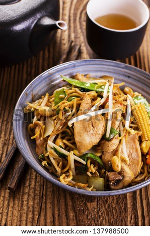 stir fried noodles with chicken - stock photo