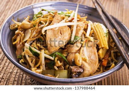 stir fried noodles with chicken and vegetables - stock photo