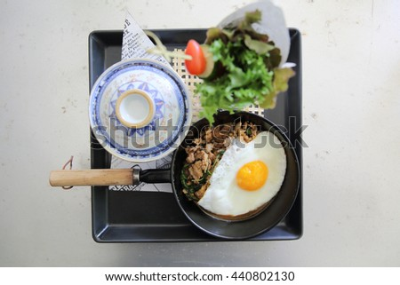 Stir fried pork and basil served with rice and fried egg , Thai food - stock photo