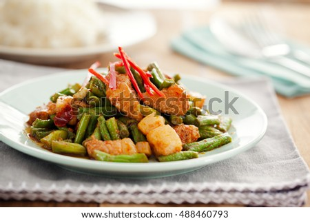 Stir fried pork and red curry paste with sting bean,thai food