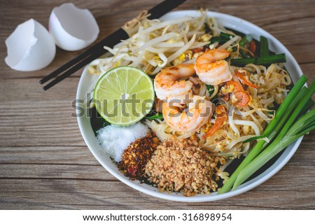 Stir-Fried Rice Noodle with Shrimps (Pad Thai), Thai Food, Thai Cuisine,Thai food rustic style,Asian Rice Noodles with Shrimps, Thai Dish Delicious - stock photo