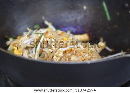 stir-fried rice noodles in pan. pad-thai. vegetarian thai food. noodle dish. - stock photo