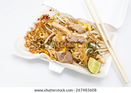 Stir-fried rice noodles or Pad Thai on white background, is the popular food in Thailand. - stock photo