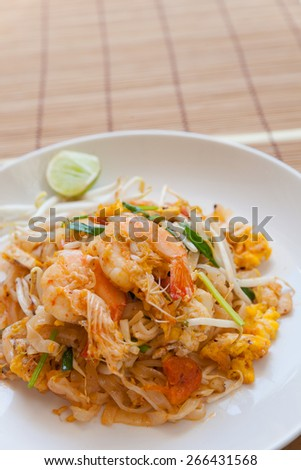 Stir-fried rice noodles (Pad Thai) is the popular food in Thailand. - stock photo