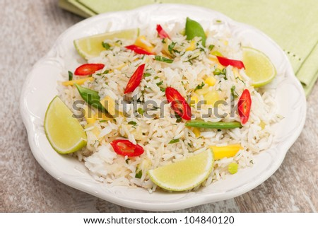 Stir fried rice with mango, lime, peas,  and chili peppers - stock photo