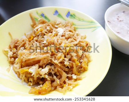 Stir fried salted turnip with egg Thai Style Breakfast - stock photo