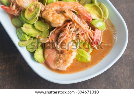 stir fried shrimps with stink bean. - stock photo