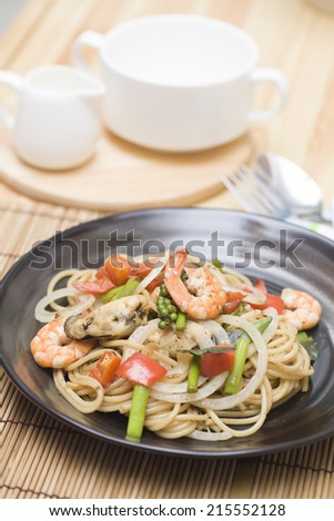 Stir fried spicy spaghetti with seafood - stock photo