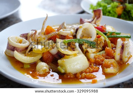 Stir fried squid with salted egg yolk with onion