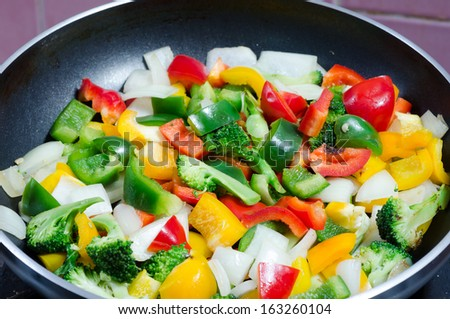 stir fried vegetables in a pan - stock photo