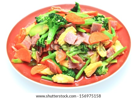 stir fried vegetables in red dish on white background.