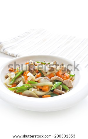 stir fried vegetables with pork in white dish