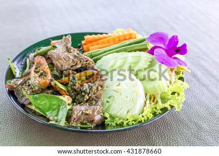 Stir fry beef spicy meat with herb and vegetable delicious Thailand food. - stock photo