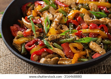 Stir fry chicken, sweet peppers and green beans - stock photo