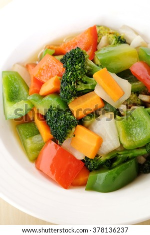 Stir fry mix vegetables on white plate