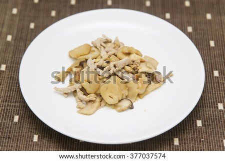 stir-fry pork and king oyster mushroom - stock photo