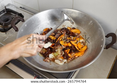 Stir fry vegetables on the wok - stock photo