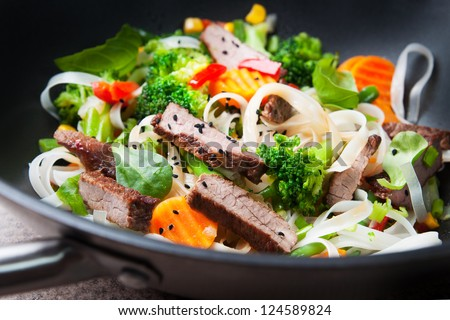 stir-fry with beef  rise noodle and vegetables - stock photo