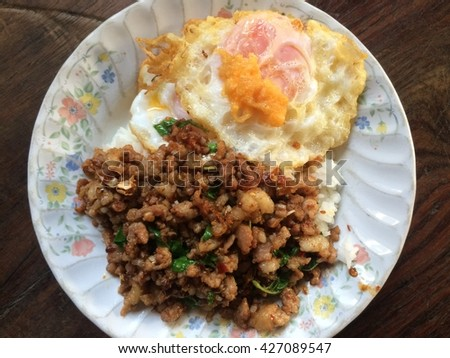 Stirred with Basil Leaves Pork Chop A fried egg on rice dish