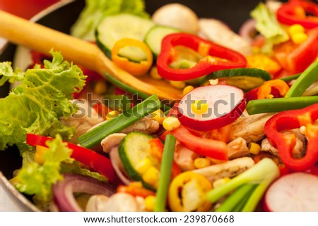 Stirring vegetables in the pan - stock photo