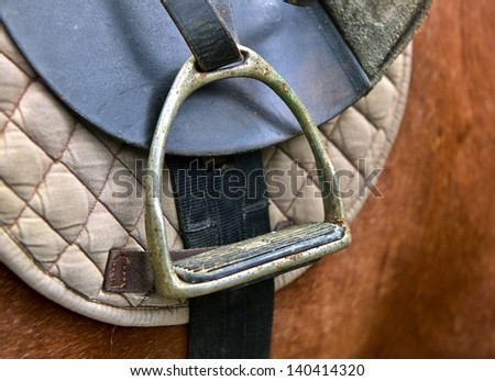 stirrup of the saddle close-up - stock photo