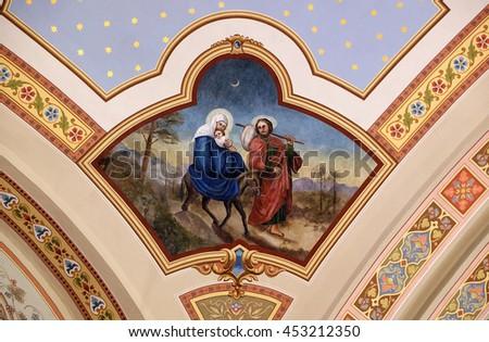 STITAR, CROATIA - AUGUST 27: Flight to Egypt, fresco in the church of Saint Matthew in Stitar, Croatia on August 27, 2015 - stock photo