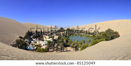 Stitched Panorama of Beautiful Huacachina Oasis surrounded by sand dunes near Ica Peru - stock photo