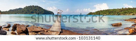 Stitched panorama of exotic tropical beach under blue sky. Thailand - stock photo