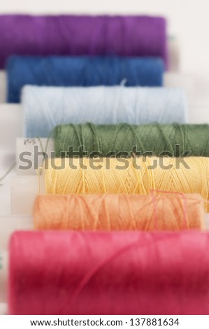 Stitching cotton collection colored in rainbow colors - stock photo
