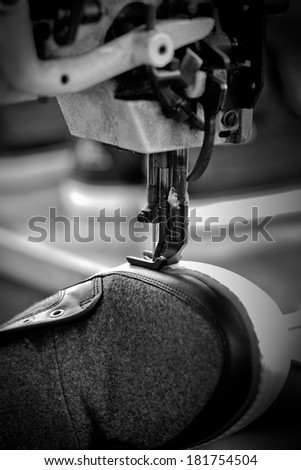 stitching shoe process in footwear industry - stock photo