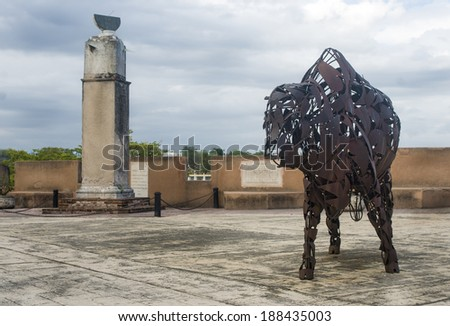 STO DOMINGO, DOMINICAN REPUBLIC - April 18 The Iconic Iron Bull of the historic Colonial Zone with the ancient sun dial on background on April 18, 2014 in Santo Domingo, Dominican Republic.