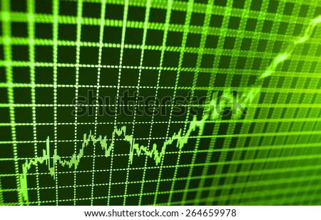 Stock chart graph of market share prices of company. Live on monitor desktop screen monitor. Business background. Green color.   - stock photo