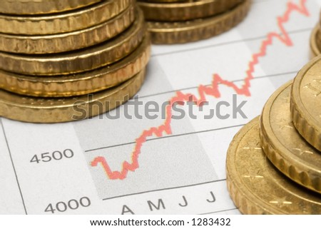Stock Chart w/ Stacked Coins - stock photo