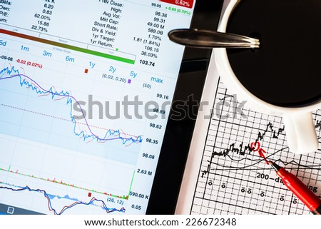 Stock Data Analysis for coffee cup, mark the red - stock photo