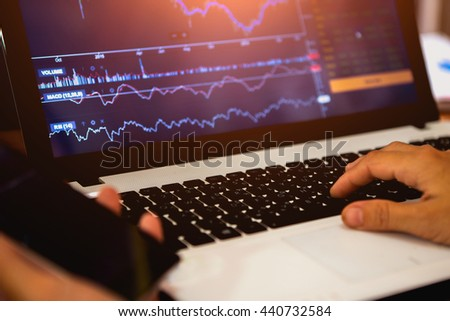 Stock graph on a notebook ( close up ) - stock photo