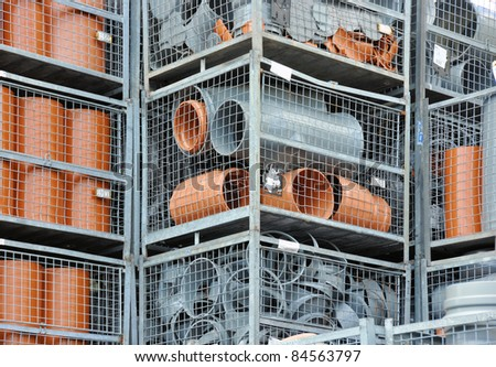 Stock gray and brown plastic pipe parts - stock photo