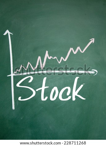 stock growth chart sign on blackboard - stock photo