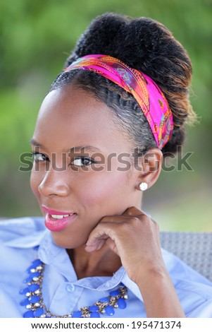 Stock head shot of a young Jamaican woman - stock photo