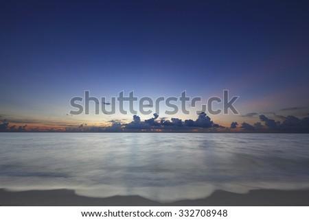 Stock image of a beautiful sunrise over the horizon - stock photo