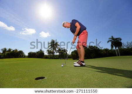 Stock image of a golfer guaging his next shot - stock photo