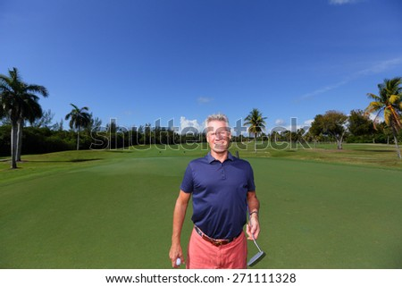 Stock image of a golfer on the green, - stock photo