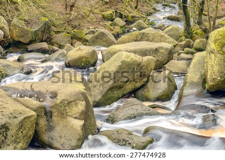 Stock image of a river running through a gorge - stock photo
