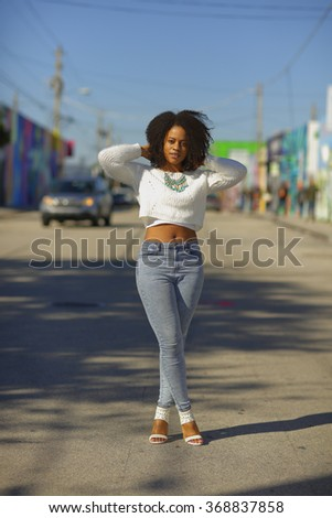 Stock image of a woman posing in the city - stock photo