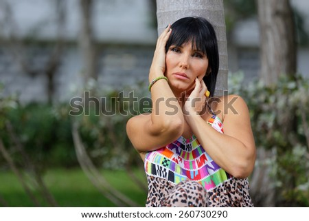 Stock image of a woman posing with her hands by her face - stock photo