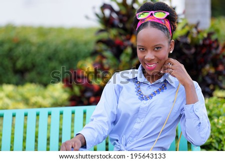 Stock image of a woman sitting and smiling at camera