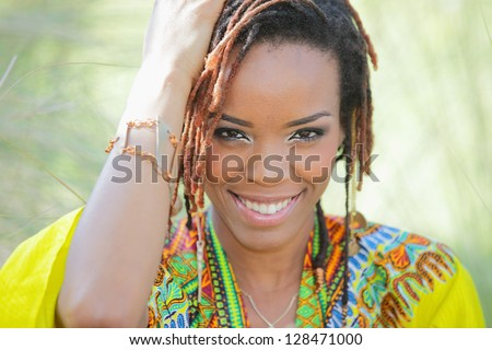 Stock image of a woman smiling and touching her head - stock photo