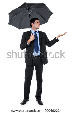 Stock image of businessman with umbrella isolated on white background - stock photo