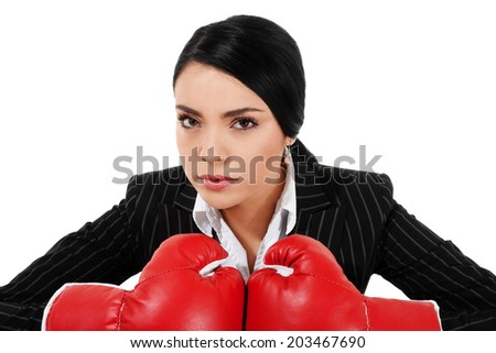 Stock image of businesswoman with boxing gloves isolated on white background - stock photo